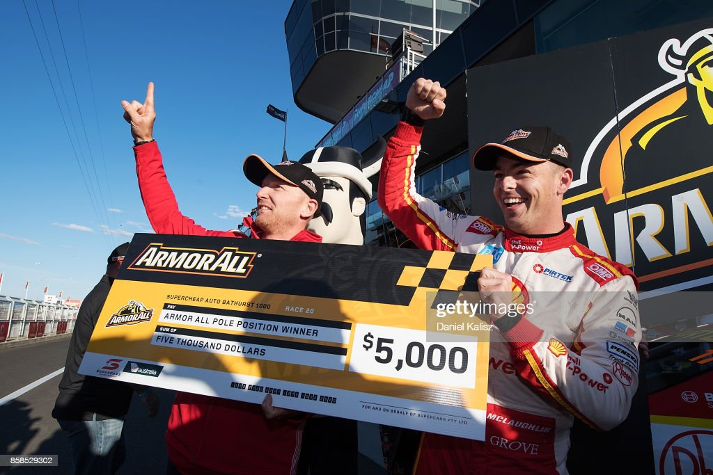Scott McLaughlin driver of the #17 Shell V-Power Racing Team Ford Falcon FGX celebrates with his team mate Alex Premat driver of the #17 Shell V-Power Racing Team Ford Falcon FGX after taking pole position during the top ten shootout ahead of this weekend's Bathurst 1000, which is part of the Supercars Championship at Mount Panorama on October 7, 2017 in Bathurst, Australia.