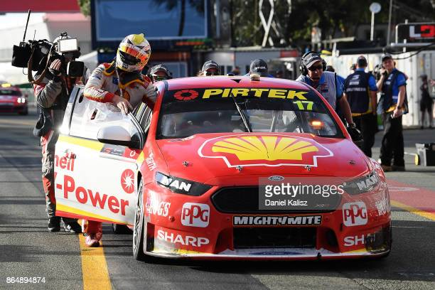 Scott McLaughlin driver of the Shell VPower Racing Team Ford Falcon FGX pushes his car into the pits after race 22 for the Gold Coast 600 which is...