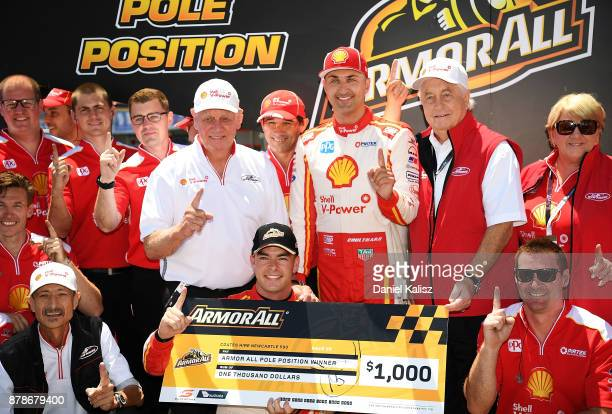 Scott McLaughlin driver of the Shell VPower Racing Team Ford Falcon FGX celebrates with Dick Johnson team owner of DJR Team Penske Roger Penske team...