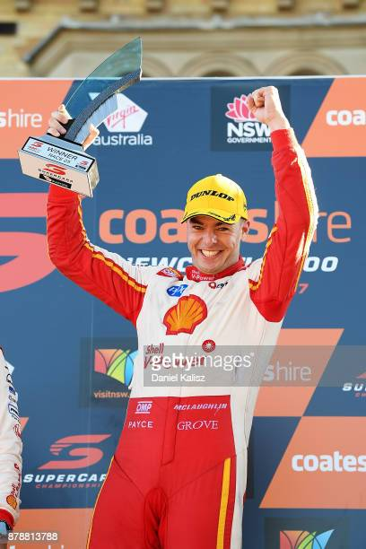 Scott McLaughlin driver of the Shell VPower Racing Team Ford Falcon FGX celebrates on the podium after winning race 25 for the Newcastle 500 which is...