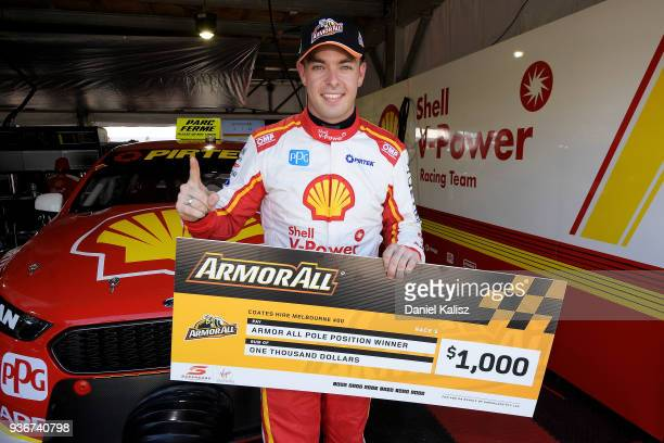 Scott McLaughlin driver of the Shell VPower Racing Team Ford Falcon FGX celebrates after taking pole position for race 3 during the Supercars...