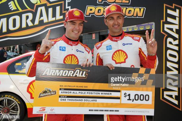 Scott McLaughlin driver of the Shell VPower Racing Team Ford Falcon FGX celebrates with his team mate Fabian Coulthard driver of the Shell VPower...