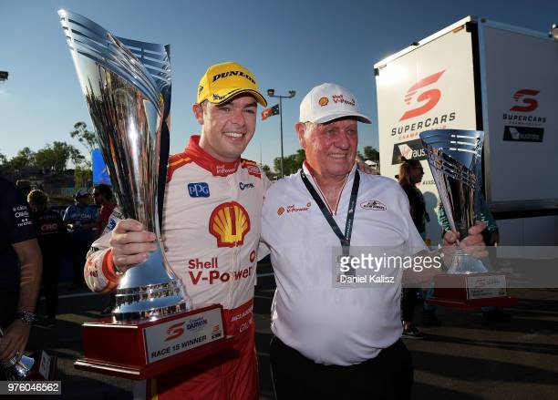 Scott McLaughlin driver of the Shell VPower Racing Team Ford Falcon FGX and Dick Johnson team owner of DJR Team Penske celebrates after race 15 for...