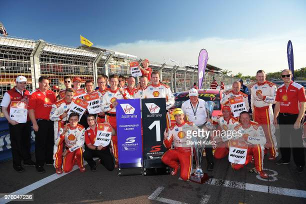 Scott McLaughlin driver of the Shell VPower Racing Team Ford Falcon FGX celebrates with Dick Johnson team owner of DJR Team Penske and his team after...