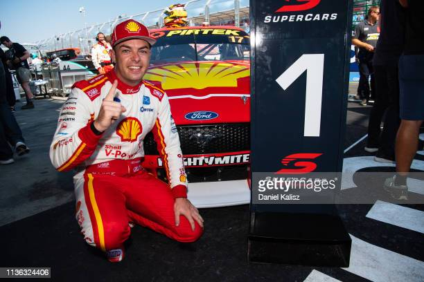 Scott McLaughlin driver of the Shell VPower Racing Team Ford Mustang celebrates after after winning race 4 for the Melbourne 400 Supercars...