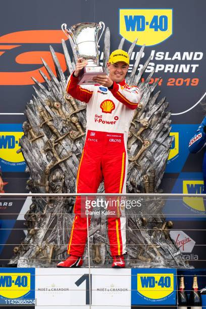 Scott McLaughlin driver of the Shell V-Power Racing Team Ford Mustang celebrates on the podium during the Phillip Island 500 as part of the Supercars...