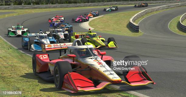 Scott McLaughlin driver of the Shell VPower Team Penske Chevrolet leads a pack of cars during the IndyCar iRacing Challenge Honda Indy Grand Prix of...