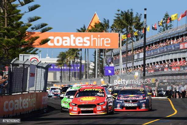 Scott McLaughlin drives the Shell VPower Racing Team Ford Falcon FGX leads the field into turn 1 at the start of race 26 for the Newcastle 500 which...