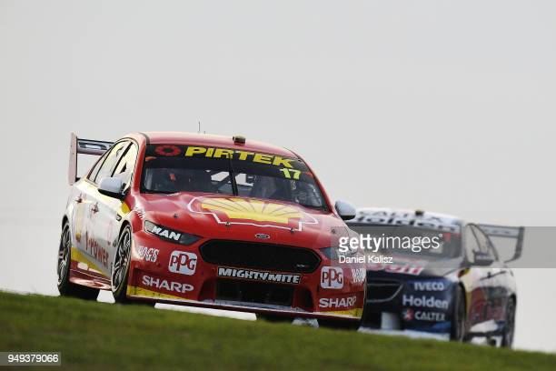 Scott McLaughlin drives the Shell VPower Racing Team Ford Falcon FGX leads Jamie Whincup drives the Red Bull Holden Racing Team Holden Commodore ZB...