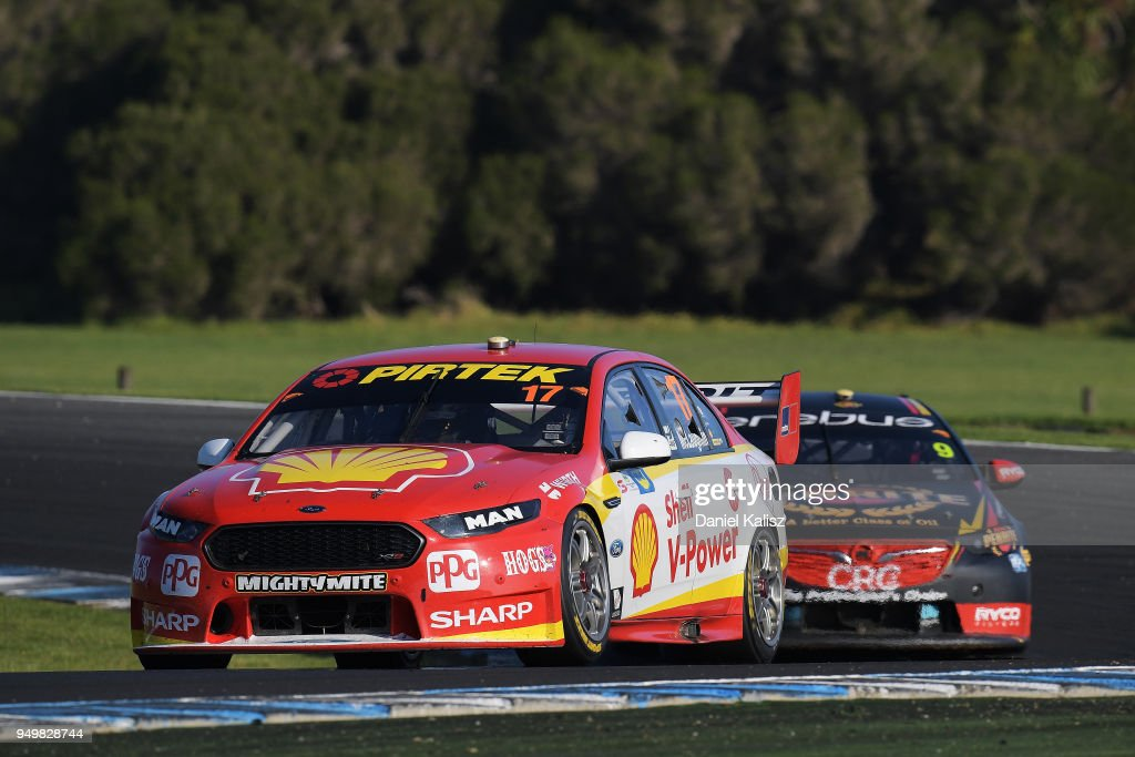 Scott McLaughlin drives the #17 Shell V-Power Racing Team Ford Falcon FGX leads David Reynolds drives the #9 Erebus Penrite Racing Holden Commodore ZB during race 10 for the Supercars Phillip Island 500 at Phillip Island Grand Prix Circuit on April 22, 2018 in Phillip Island, Australia.