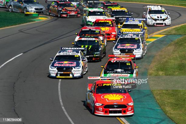 Scott McLaughlin drives the Shell VPower Racing Team Ford Mustang leads the field at the start of race 4 for the Melbourne 400 Supercars Championship...