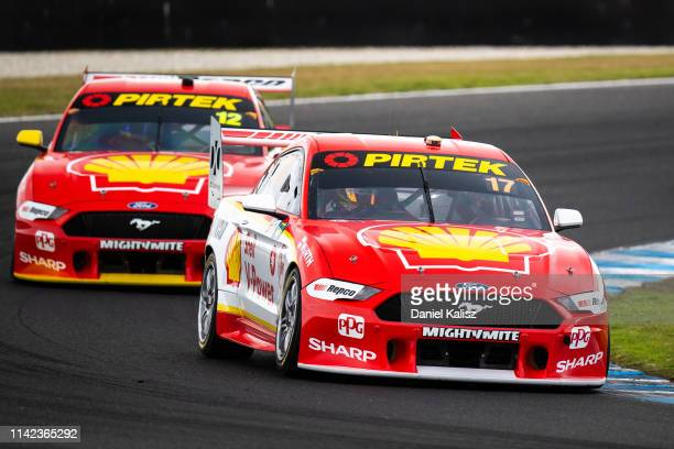Scott McLaughlin drives the Shell V-Power Racing Team Ford Mustang leads Fabian Coulthard drives the Shell V-Power Racing Team Ford Mustang during...