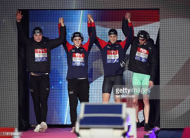 Scott McLay, Max Litchfield, James Guy and Duncan Scott of Great Britain prepare to compete in the Men's 4 x 50m Freestyle Relay final during day one...