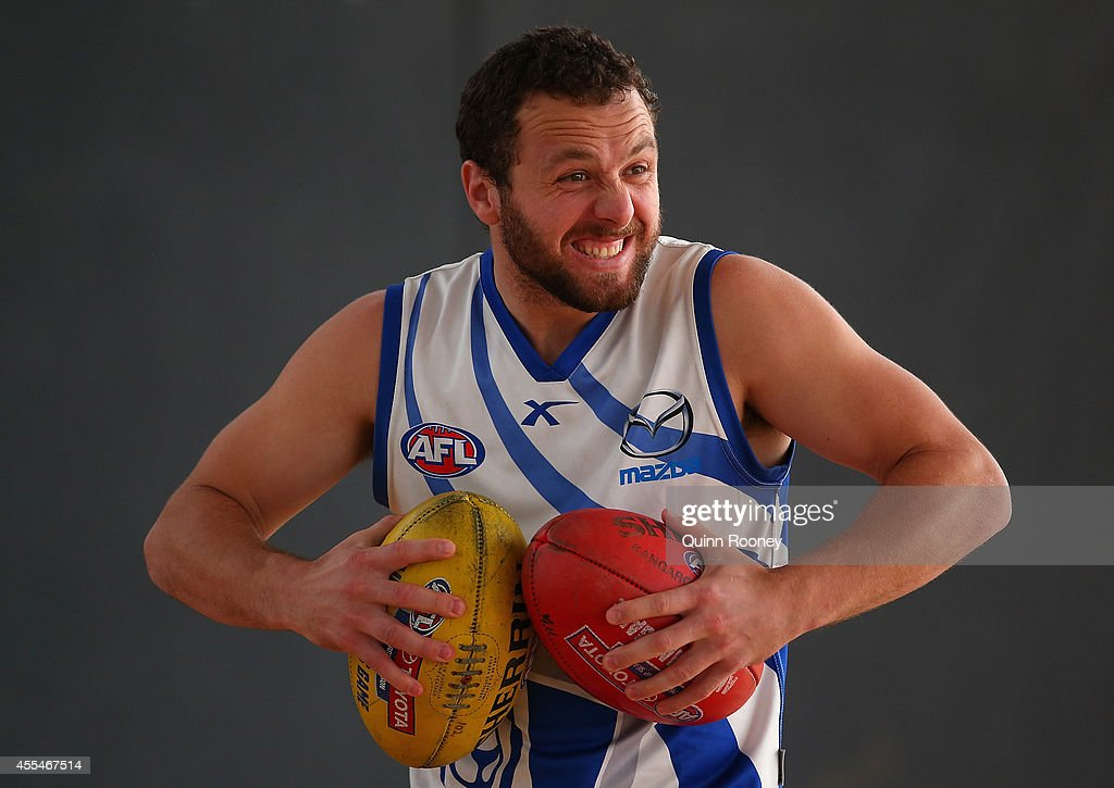 Scott McMahon of the Kangaroos has a laugh during a North Melbourne Kangaroos AFL training session at Arden Street Ground on September 15, 2014 in Melbourne, Australia.