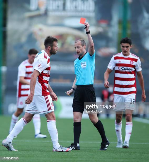 Scott McMann of Hamilton is sent off by referee William Collum during the Ladbrokes Scottish Premiership match between Hamilton Academical and...
