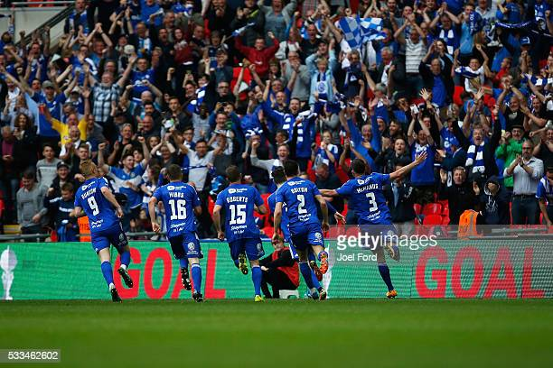 Scott McManus of FC Halifax Town celebrates his goal with teammates during the FA Trophy Final match between Grimsby Town FC v FC Halifax Town at...