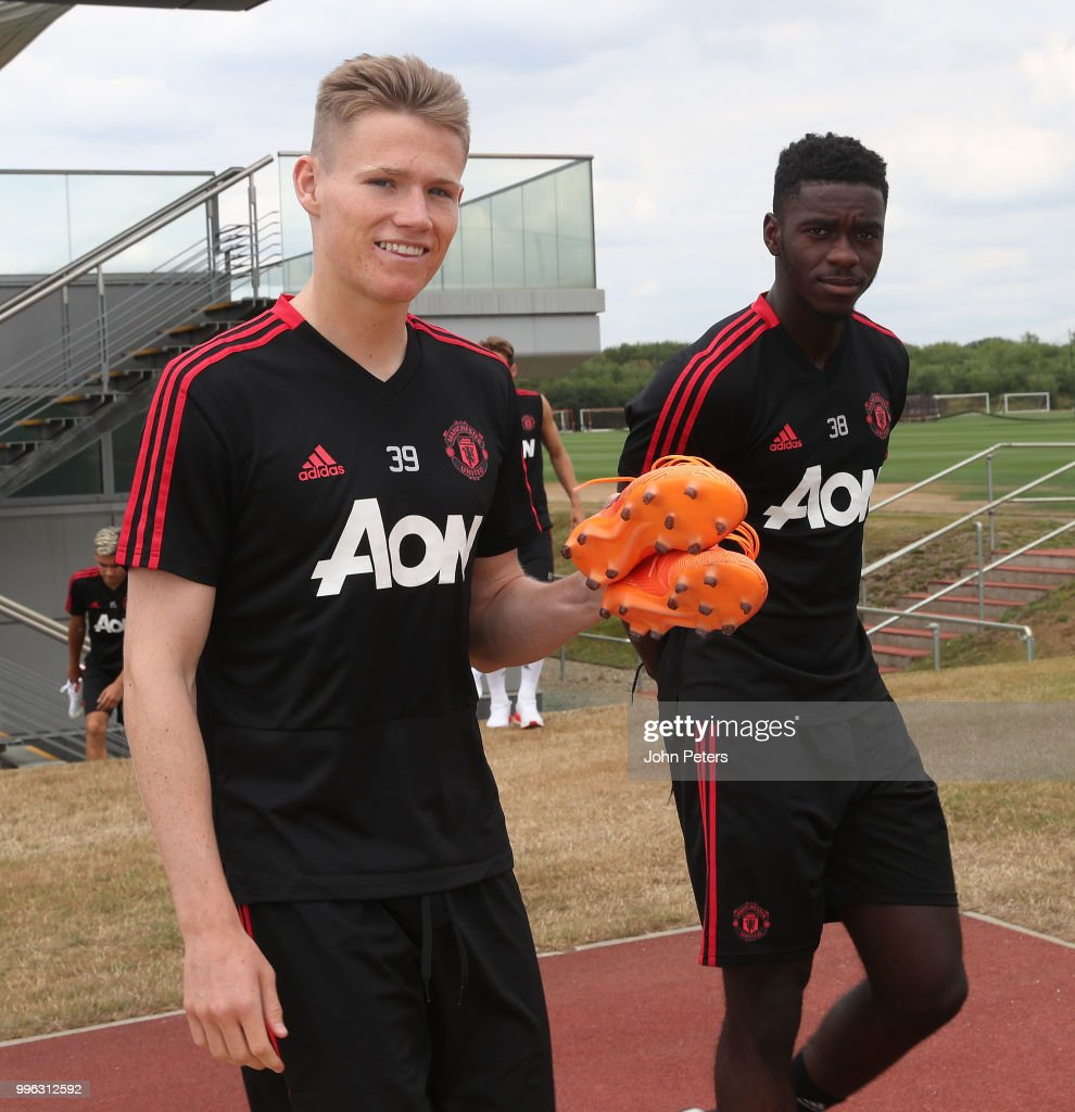 Scott McTominay and Axel Tuanzebe of Manchester United walk out ahead of a first team training session at Aon Training Complex on July 11, 2018 in Manchester, England.