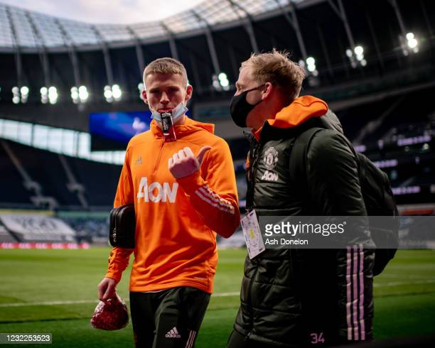 Scott McTominay and Donny van de Beek of Manchester United leave the stadium at the end of the Premier League match between Tottenham Hotspur and...