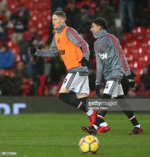 Scott McTominay and Jesse Lingard of Manchester United warm up ahead of the Premier League match between Manchester United and AFC Bournemouth at Old...