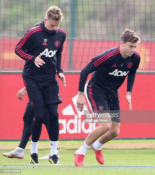 Scott McTominay and Victor Lindelof of Manchester United in action during a first team training session at Aon Training Complex on September 1 2018...