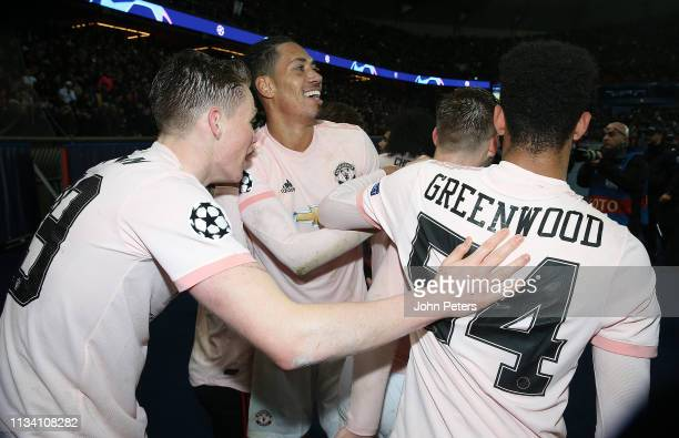 Scott McTominay Chris Smalling ad Mason Greenwood of Manchester United celebrates at the final whistle during the UEFA Champions League Round of 16...