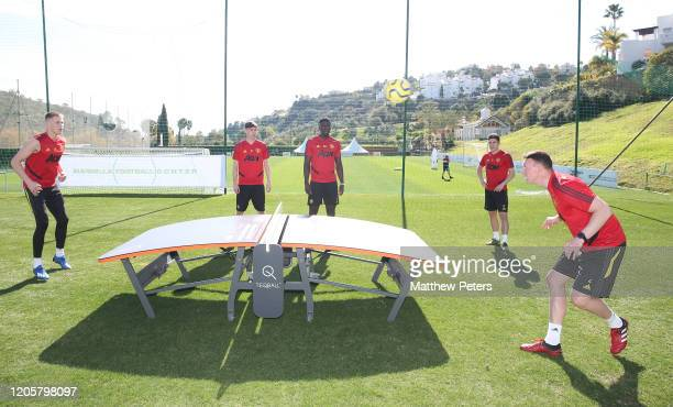Scott McTominay, James Garner, Axel Tuanzebe, Daniel James and Phil Jones of Manchester United in action during a first team training session on...
