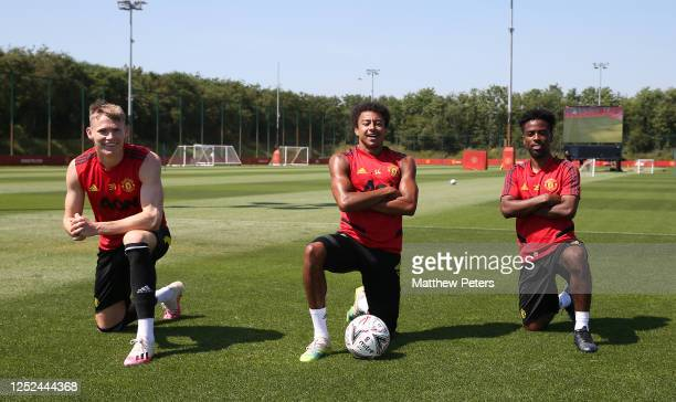 Scott McTominay, Jesse Lingard and Angel Gomes of Manchester United in action during a first team training session at Aon Training Complex on June...