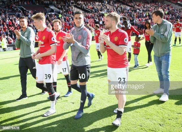 Scott McTominay Joel Pereira and Luke Shaw of Manchester United take part in a lap of honour after the Premier League match between Manchester United...