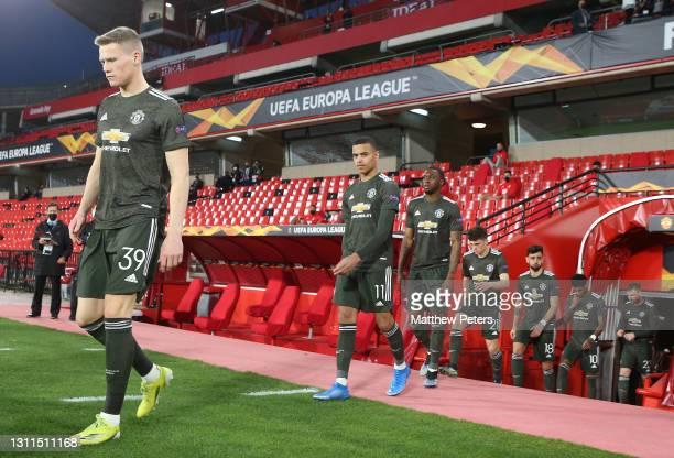 Scott McTominay, Mason Greenwood, Aaron Wan-Bissaka of Manchester United walk out ahead of the UEFA Europa League Quarter Final First Leg match...