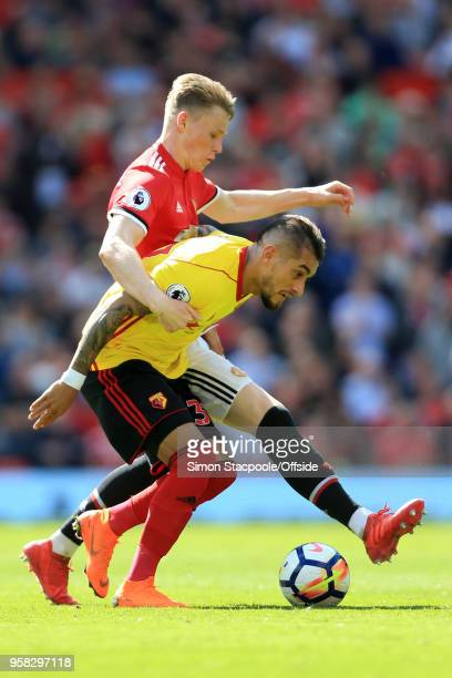 Scott McTominay of Man Utd battles with Roberto Pereyra of Watford during the Premier League match between Manchester United and Watford at Old...