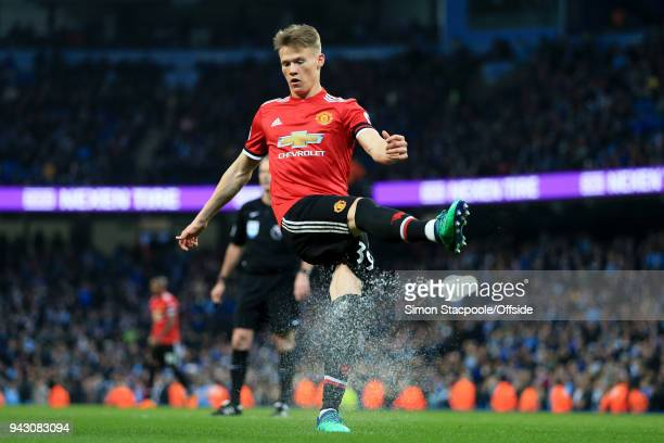 Scott McTominay of Man Utd kicks a plastic cup of water off the pitch during the Premier League match between Manchester City and Manchester United...
