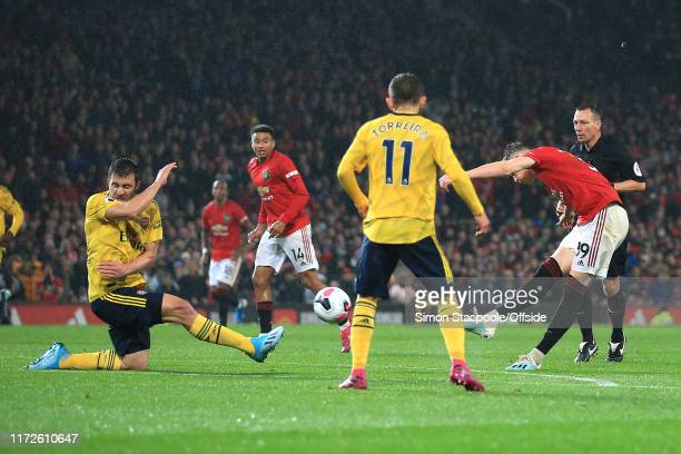 Scott McTominay of Man Utd scores the opening goal during the Premier League match between Manchester United and Arsenal FC at Old Trafford on...