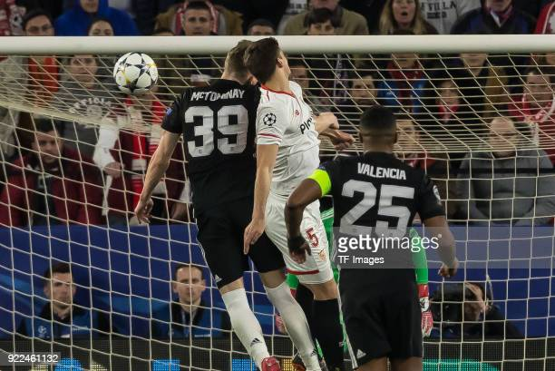 Scott McTominay of Manchester United and Clement Lenglet of Sevilla battle for the ball during the UEFA Champions League Round of 16 First Leg match...