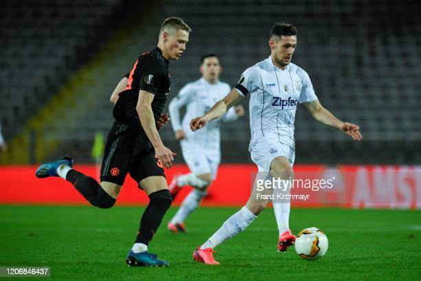 Scott McTominay of Manchester United and Husein Balic of LASK during UEFA Europa League Round of 16 First Leg match between LASK and Manchester...
