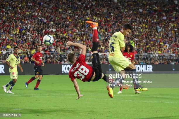 Scott McTominay of Manchester United and Jose Guillen of Club America in action during the International Champions Cup game at the University of...