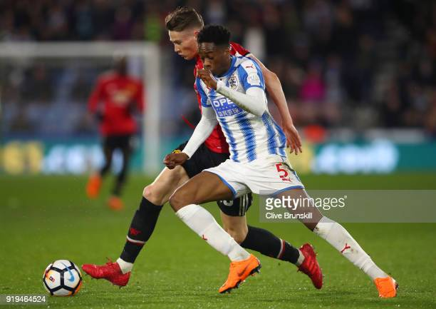Scott McTominay of Manchester United and Terence Kongolo of Huddersfield Town in action during the The Emirates FA Cup Fifth Round between...
