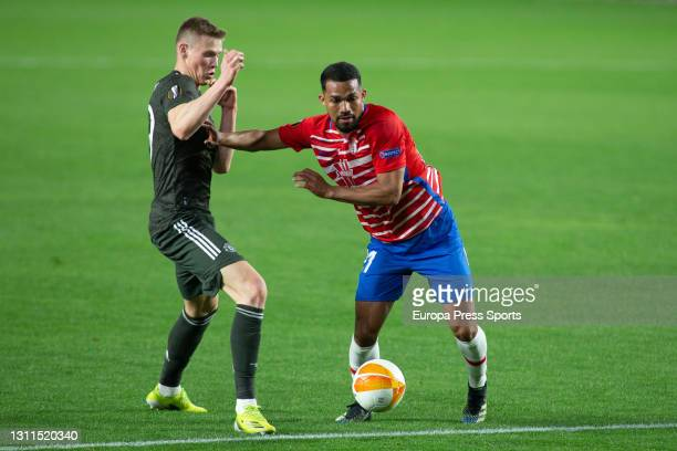Scott McTominay of Manchester United and Yangel Herrera of Granada in action during the UEFA Europa League, Quarter Final First Leg, football match...