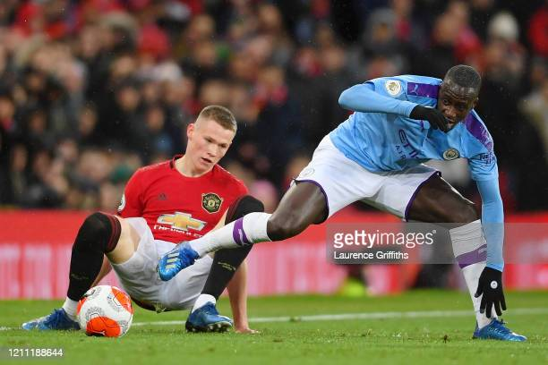 Scott McTominay of Manchester United battles for possession with Benjamin Mendy of Manchester City during the Premier League match between Manchester...