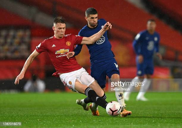Scott McTominay of Manchester United battles for possession with Christian Pulisic of Chelsea during the Premier League match between Manchester...