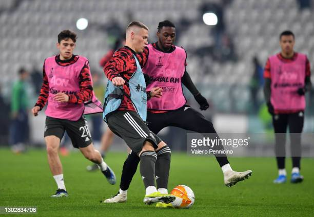 Scott McTominay of Manchester United battles for possession with Aaron Wan-Bissaka of Manchester United during the warm up ahead of the UEFA Europa...