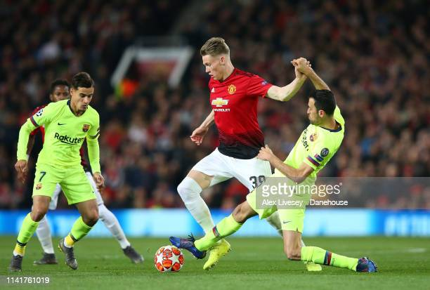 Scott McTominay of Manchester United beats Sergio Busquets of FC Barcelona during the UEFA Champions League Quarter Final first leg match between...