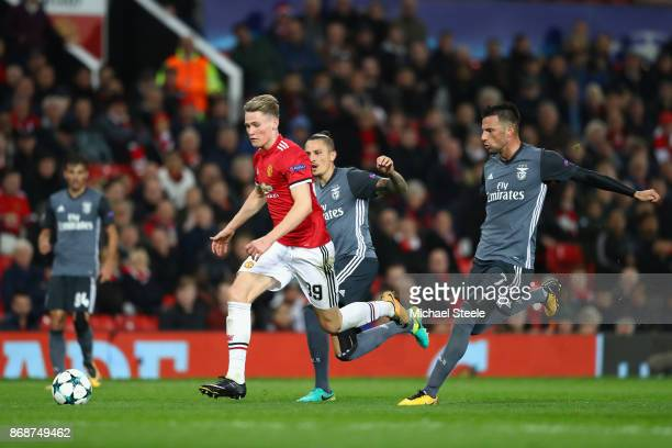 Scott McTominay of Manchester United breaks free from Andreas Samaris of Benfica during the UEFA Champions League group A match between Manchester...