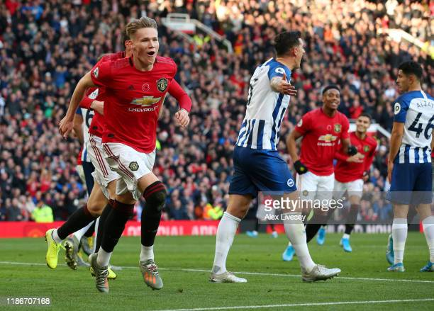 Scott McTominay of Manchester United celebrates after his team's second goal an own goal from Davy Propper of Brighton and Hove Albion during the...