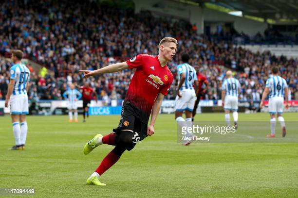 Scott McTominay of Manchester United celebrates after scoring his team's first goal during the Premier League match between Huddersfield Town and...