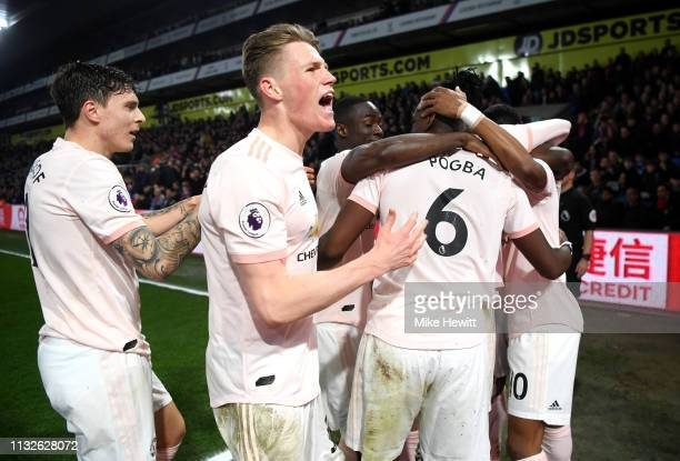 Scott McTominay of Manchester United celebrates his team's third goal scored by Ashley Young of Manchester United during the Premier League match...