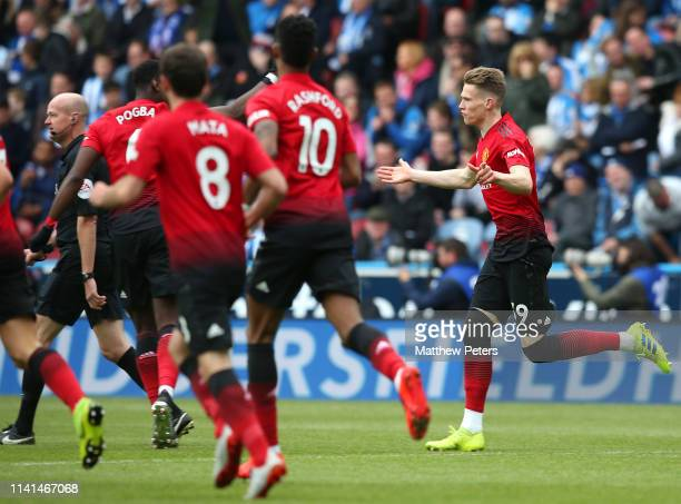 Scott McTominay of Manchester United celebrates scoring the first goal during the Premier League match between Huddersfield Town and Manchester...