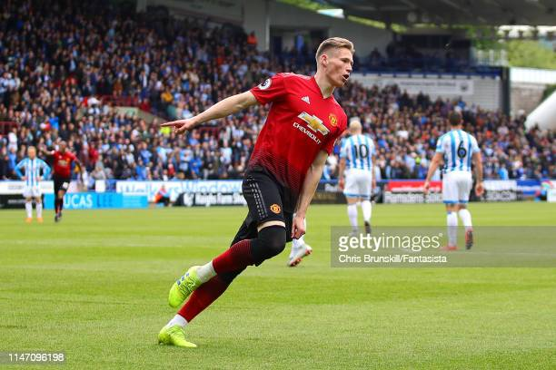 Scott McTominay of Manchester United celebrates scoring the opening goal during the Premier League match between Huddersfield Town and Manchester...