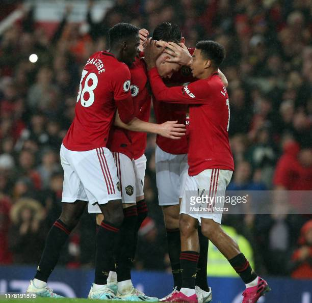 Scott McTominay of Manchester United celebrates scoring their first goal during the Premier League match between Manchester United and Arsenal FC at...