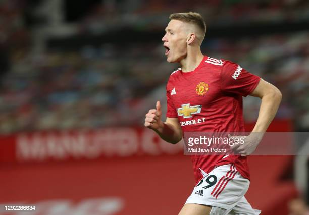 Scott McTominay of Manchester United celebrates scoring their first goal during the Premier League match between Manchester United and Leeds United...