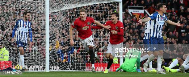 Scott McTominay of Manchester United celebrates scoring their second goal during the Premier League match between Manchester United and Brighton Hove...
